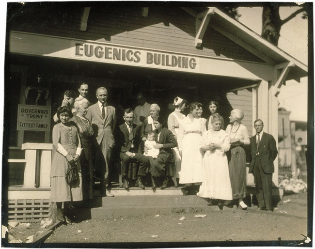 Winners of a Fitter Family contest stand outside the Eugenics Building at the Kansas Free Fair in Topeka, KS, where families are registered for the contests.Winners of a Fitter Family contest stand outside the Eugenics Building at the Kansas Free Fair in Topeka, KS, where families are registered for the contests.