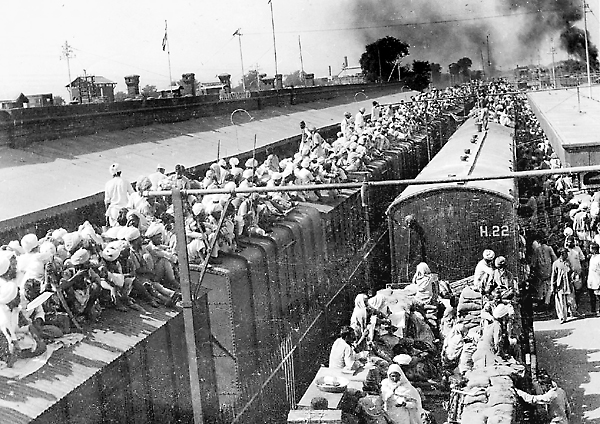 A train loaded to capacity at a railway station in the Punjab, waiting to take passengers into exile following Partition.