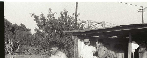 Migrant workers being fumigated with DDT at the Hidalgo Processing Center, Texas (Bracero Archive).