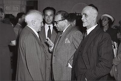 Israeli Prime Minister David Ben-Gurion chats with the Iranian special envoy in Israel, Reza Saffinia, at a party given by the Iranians. Between them is Shmuel Divon, then acting director of the Middle Eastern Division. 1 June 1950. Photograph: Teddy Brauner, Israeli Government Press Office.