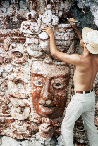 "An antiquities smuggler in the process of looting a large stucco temple facade at the Maya site of Placeres, Mexico (Photo from DayOfArchaeology.com ""with permission of individual pictured."")"