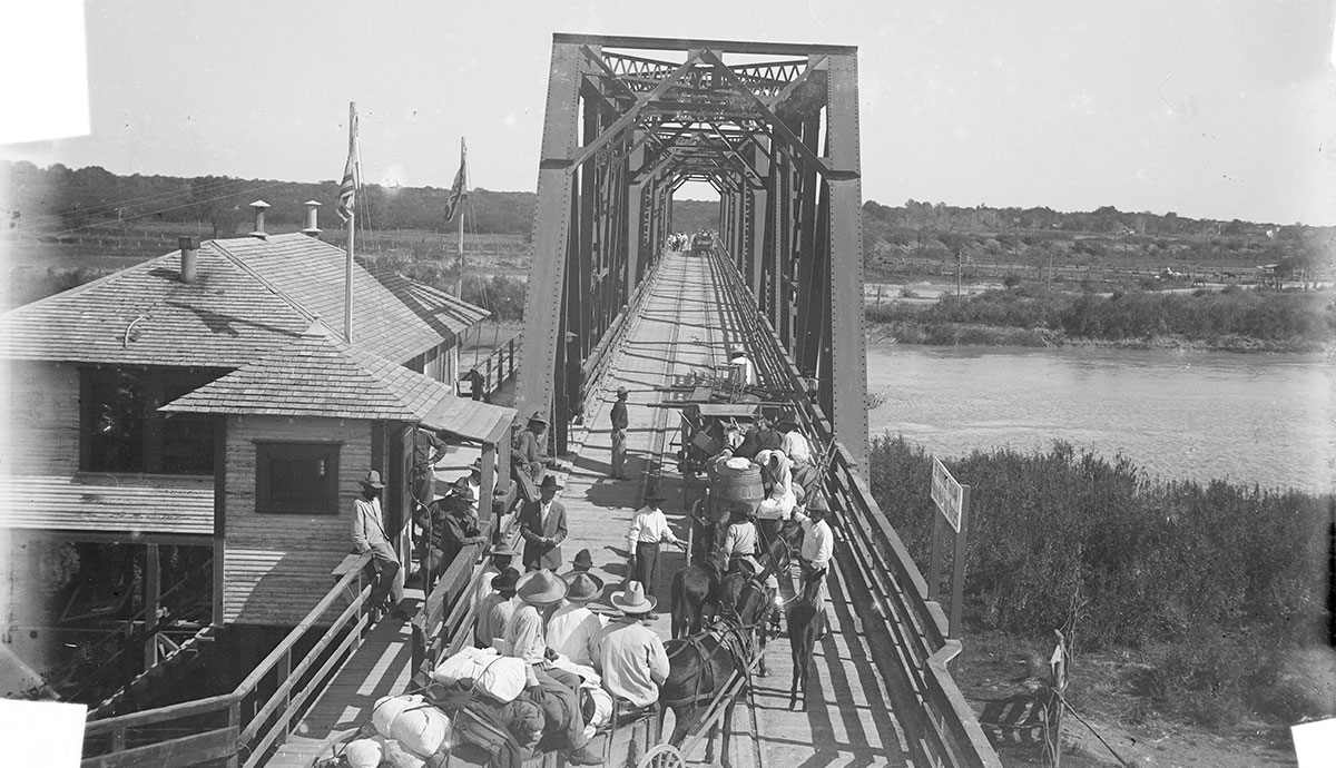 Frequent border crossings by local residents in both directions were an accepted part of daily life in Brownsville, Texas throughout the 19th century. People crossing from one border town to another could freely walk, ride across the bridge, or take one of hundreds of simple ferries. (Courtesy Robert Runyon Photograph Collection, RUN03751, The Dolph Briscoe Center for American History, The University of Texas at Austin.)