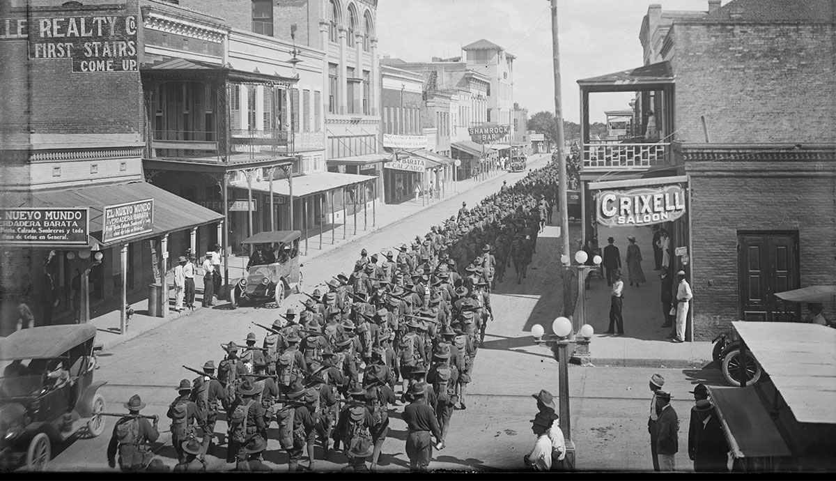 Soldiers parade down Elizabeth Street in Brownsville, circa 1916. (Courtesy Robert Runyon Photograph Collection, RUN01308, The Dolph Briscoe Center for American History, The University of Texas at Austin.)
