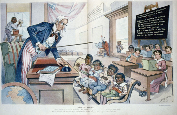 "This 1899 cartoon depicts Cuba, Puerto Rico, Hawaii, and the Philippines as unruly children who must be compelled to learn their lessons in civilization before they can join the rest of the class. In the corner sits a Native American ""dunce"" whose book is upside-down, and an African American child must clean the school's windows rather than participate."