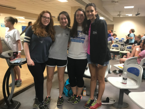 four students at the bowling alley