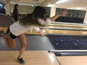 student in action of bowling