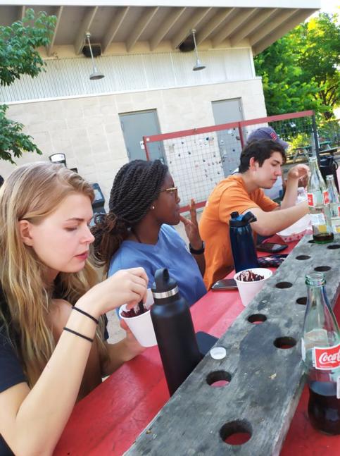 students eating food at food truck park