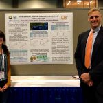 "Picture of Nelida Herrera and Brian Wolshon with their CM2 poster, ""Assessment of post-disaster reentry in Megaregions"""