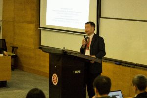Photo of Dr. Zhang presenting at the 2018 International Conference on Future Urban Development: Sustainable City-Region Governance.