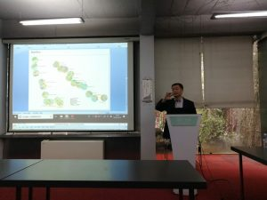 Photo of Dr. Ming Zhang speaking at the Fourth International Symposium on Land Use, Transport Infrastructure, and Sustainable Development at Tongji University, Shanghai, China.