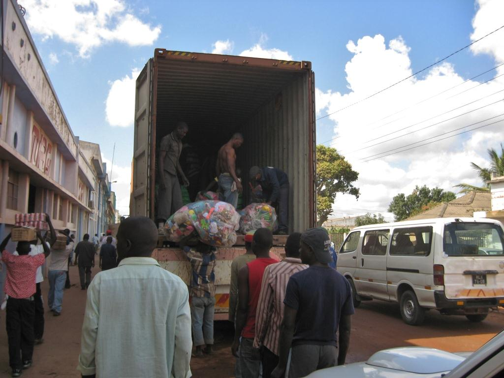 Workers unloading used toys and clothes