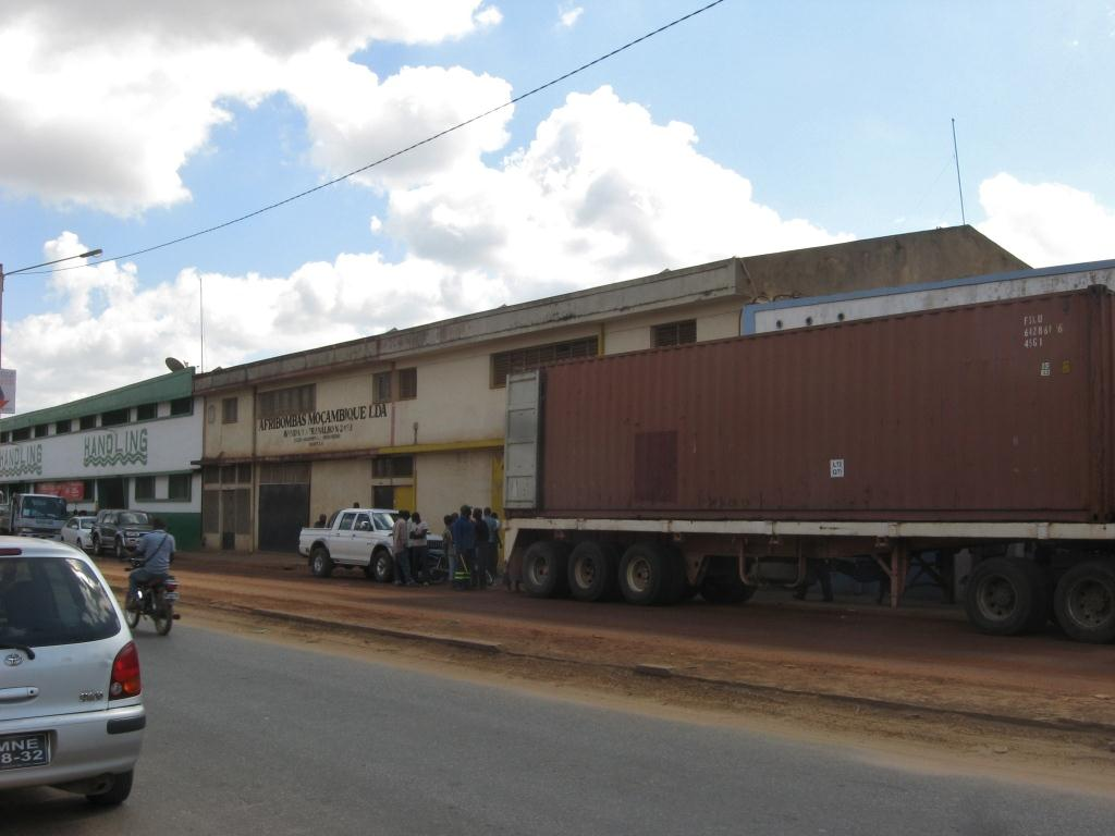 Large container truck parked in front of the warehouse