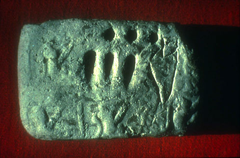 (Fig. 5)  Incised tablet from Godin Tepe, Iran, ca. 3100 BC. courtesy Cuyler Young Jr.,  Royal Ontario Museum, Toronto. The incised sign stands for a jar of oil, the circular signs stand for 10, the wedges for 1 = 33 jars of oil.