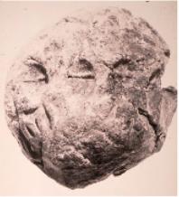 Envelope showing the imprint of three ovoid tokens with an incised line representing jars of oil, from Habuba Kabira, Syria, ca. 3300 B.C. Courtesy Museum für vor- und Frühgeschichte, Schloss Charlottenburg, Berlin.