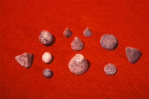 Eleven cone shaped tokens