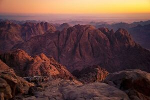 Sinai mountains with a yellow. pink. and purple sky
