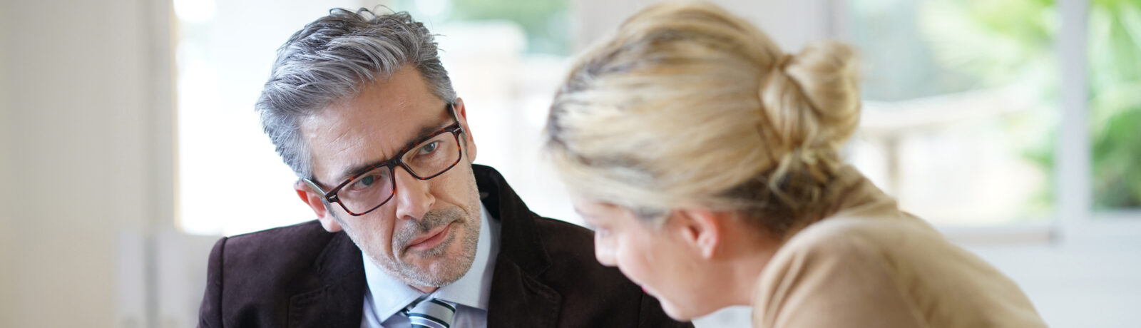 Financial adviser working with a client.