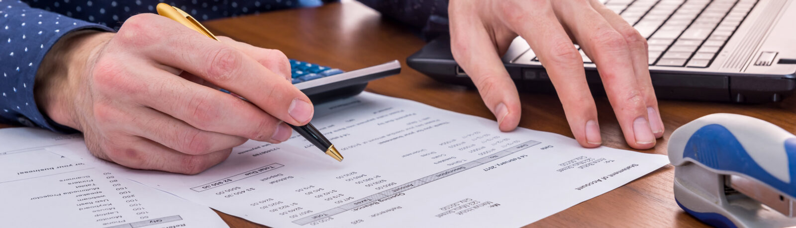 Accountant filling out a sheet.