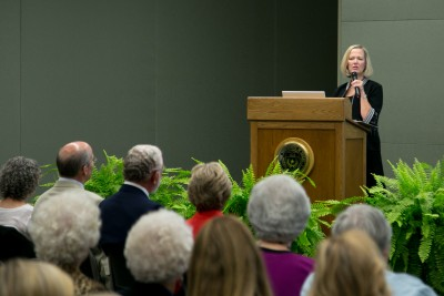 dean at podium during lecture