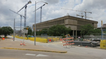 construction cranes over the UT Austin School of Nursing