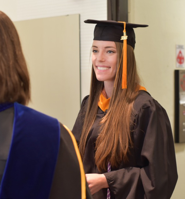 Woman graduate in cap and gown