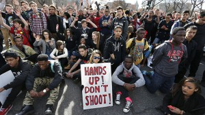 East High School students in Denver participate in a protest against the Ferguson, Missouri grand jury decision, in a busy intersection in front of the state Capitol, Wednesday Dec. 3, 2014. (AP Photo/Brennan Linsley)