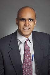 headshot of Raja