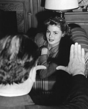 Director Alfred Hitchcock frames Ingrid Bergman in a still from the set of 'Spellbound' (1945)