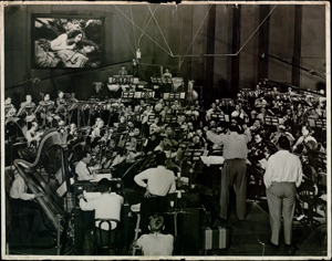 Photograph of Dimitri Tiomkin conducting orchestra for Duel in the Sun, 1946