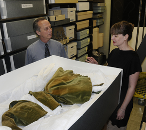 Film Curator Steve Wilson and Jill Morena, Collection Assistant for Costumes and Personal Effects, with the original curtain dress from 'Gone With The Wind.'