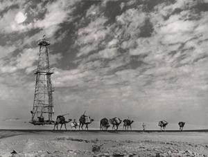 David Douglas Duncan. 'Aramcovid  derrick at Abqaiq. Bedouin caravan to oblivion.' Saudi Arabia, 1947.