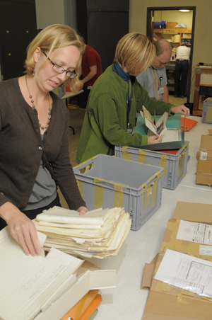 Materials from an incoming literary collection are checked by Ransom Center staff before they are sent to be cataloged. If infect infestation, mold, or other issues are detected, the conservation department treats the items. Photo by Pete Smith.
