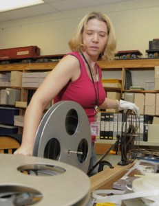 University graduate student and film collection volunteer Sandra Yates splices together outtakes of footage from film and theater producer Lewis Allen's collection. Photo by Pete Smith.
