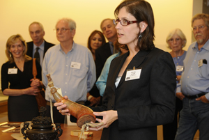 Associate Curator of Performing Arts Helen Adair shares holdings from the Erle Stanley Gardner archive at a reception for new members. Photo by Anthony Maddaloni.