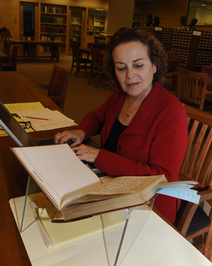 Judith Freeman, author of 'The Long Embrace: Raymond Chandler and The Woman He Loved,' researches the archive of jazz journalist and historian Ross Russell. Freeman is a recipient of a fellowship funded by the Erle Stanley Gardner Endowment for Mystery Studies. Photo by Anthony Maddaloni.