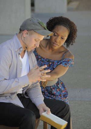 Actors Adam Couperthwaite and Robbie Ann Darby perform in 'No Snakes in This Grass,' a one-act play by James Magnuson, director of the Michener Center for Writers. Prior to Thanksgiving, The University of Texas at Austin Graduate School and the James A. Michener Center for Writers hosted the event outside the Ransom Center. Photo by Pete Smith.