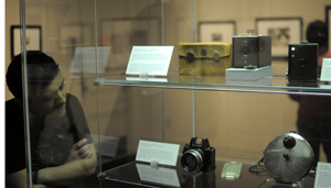 Cameras on display in the exhibition 'Discovering the Language of Photography: The Gernsheim Collection.'  Shown here are cameras ranging in date from 1886 to 1925, including the first Kodak camera and a circular 19th century detective camera that was used while being concealed under a jacket or vest. Photo by Anthony Maddaloni.