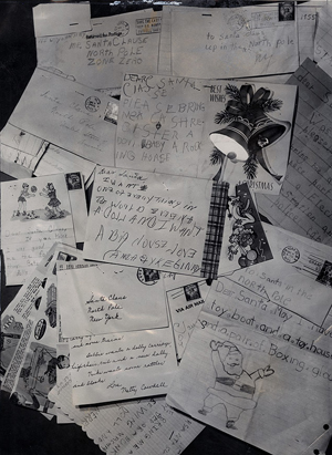Some of the thousands of 'Dear Santa' letters received at the General Post Office at Christmastime. December 13, 1955. New York Journal American collection.