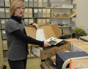 Archivist Amy Armstrong works on cataloging the collection of screenwriter and director Paul Schrader, locating a costume worn by Willem Dafoe in 'Light Sleeper' (1992). Photo by Anthony Maddaloni.
