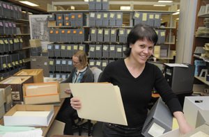 Assistant Archivist Nicole Davis (left) and Archivist Jennifer Hecker work on cataloging the papers of lawyer Morris Ernst. Some of the more than 900 processed and unprocessed boxes of the Ernst collection surround Davis and Hecker as they work on making the collection accessible in fall 2011. Photo by Anthony Maddaloni.