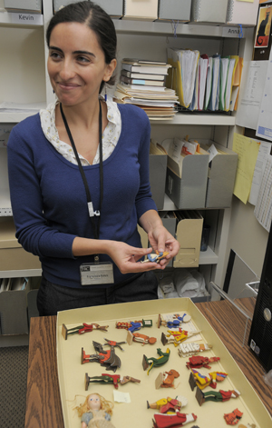 Graduate intern Francisca Folch works with the Byron and Susan Sewell Collection of Lewis Carroll, evaluating the collection's dolls and figurines relating to 'Alice in Wonderland'. Photo by Anthony Maddaloni.
