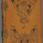 "C. H. A. Bjerregaard's ""Sufi Interpretations of the Quatrains of Omar Khayyam and Fitzgerald"" (New York: J. F. Taylor, 1902). Numbered edition, no. 1 of 5. The Stark Library. Bound in brown pigskin, this painted cover lavishly depicts Omar's vines of wisdom, each line of the drawing seared into place by a heated tool or flame. True to Bjerregaard's vow to explore the ""mines under the vineyard,"" the pages between the decorated covers—rich with watercolor paintings, additional pyrographic illustrations, and brocade backed endpapers—reveal further artistic enhancements. One of only five printed, this opulent ""Jamshyd"" copy presents Bjerregaard's anti-sensualist pairing of the famous quatrains with Sufi wisdom. Photo by Pete Smith."