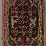"""Book of Common Prayer"" (London: Christopher Barker, 1586). Embroidered with silver cord and thread, this rare surviving example of textile binding features red velvet covers decorated with spangles. Although the exact date of this binding is unknown, it closely resembles the embroidered velvet Bible presented by the same printer, Christopher Barker, to Queen Elizabeth I as a New Year's gift in 1584. The identity of 'F. S.' remains a mystery, but the gauffered edges—gilded, and then impressed with patterns by a heated tool—indicate that this book was owned by a member of the upper class. A final clue to the mysterious owner's status lies in a 1638 statement by a guild of English embroiderers, who claimed that their book covers were fit for the ""Nobility and Gentry of this kingdome… and not for common persons."" Photo by Pete Smith."