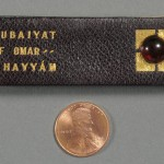 """The Rubáiyát of Omar Khayyám of Naishápúr"" (Needham, MA: Rosemary Press, 1916). Miniature Book Collection. This tiny ""Rubáiyát,"" like others in its series, is bound in Russian leather and hand-tooled in gold. It was one of only 60 published by Rosemary Press, founded by Charles Dana Burrage (1857–1926), a Boston lawyer, naturalist, Orientalist, and the first president of the University of California Club of New England. His wee books were given as party favors at club events. Photo by Pete Smith."