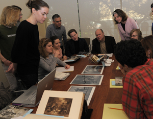 Students in Professors Robert Abzug and Steven Hoelscher's graduate seminar 'Photography in American Culture' view materials from the Ransom Center's photography collections, including photos from the Arnold Newman archive. Photo by Anthony Maddaloni.