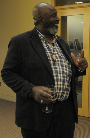 Eli Reed, Magnum photographer and Professor of Photojournalism at The University of Texas at Austin, spoke about a selection of his work to the Ransom Center's Friends of Photography. Photo by Anthony Maddaloni.