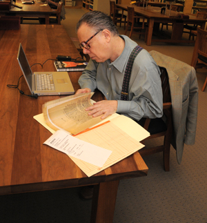John Lahr, Senior Drama Critic of The New Yorker, at work in the Ransom Center's reading room. Lahr presented the Harry Ransom Lecture, 'Tennessee Williams and the Out-Crying Heart,' Thursday evening and is currently working on a biography of Tennessee Williams. Photo by Anthony Maddaloni.