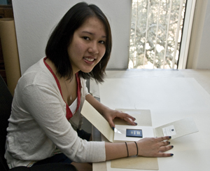 Undergraduate Student Assistant  Elizabeth Phan, with one of her recent housing projects, was one of 10 finalists for the university's Student Employee of the Year Award. Phan has worked in the preservation and housing department at the Ransom Center for three years. Photo by Anthony Maddaloni.