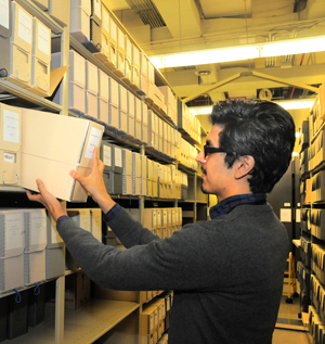 Library Assistant Emilio Banda returns paged manuscript materials to the stacks.  Photo by Pete Smith.