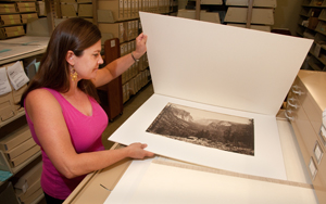 Photographic Archivist Mary Alice Harper with one of photographer Carleton Watkins's images of Yosemite. Photo by Pete Smith.